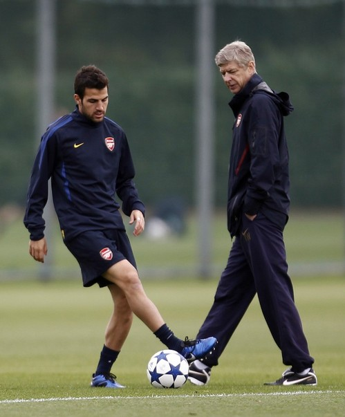 arsenal-manager-arsene-wenger-watches-as-cesc-fabregas-contr.jpg