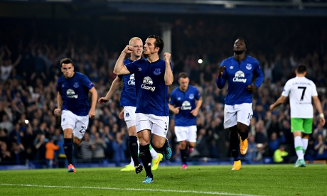 Leighton Baines celebrates after scoring Everton's third goal from the penalty spot against Wolfsbur