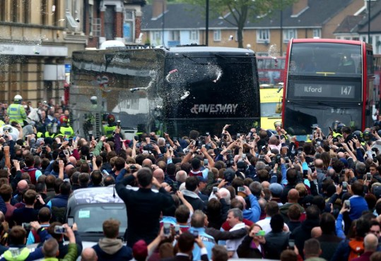LONDON, ENGLAND - MAY 10:  Bottles, beer and missiles are thrown at the Manchester United team bus as it tries to make it's way through the crowds that had congregated in the street prior to the Barclays Premier League match between West Ham United and Manchester United on May 10, 2016 in London, United Kingdom.  (Photo by Catherine Ivill - AMA/Getty Images)