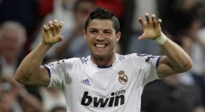 Real Madrid's Cristiano Ronaldo from Portugal reacts after scoring against Tottenham Hotspur during a quarter final, 1st leg Champions League soccer match at the Santiago Bernabeu stadium in Madrid, Tuesday April 5, 2011. Real Madrid won the match 4-0. (AP Photo/Paul White)